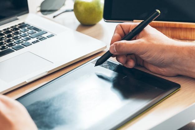 Graphic designer using a pen tablet Premium Photo
