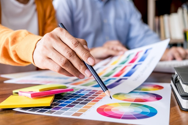 Graphic designer working on color selection and color swatches Premium Photo