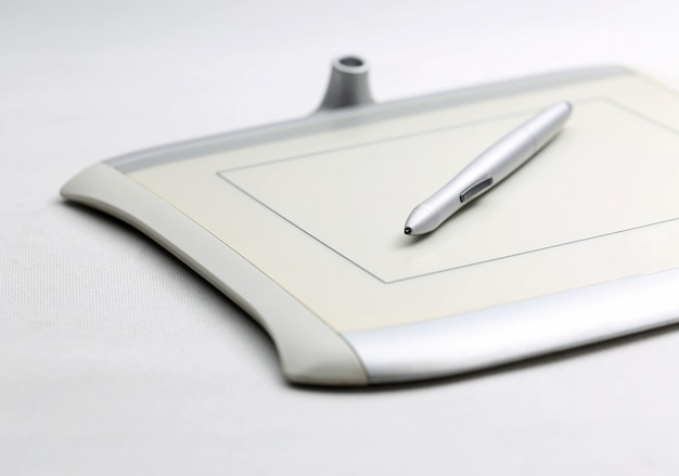 Graphic tablet and pressure sensitive pen on white background Free Photo