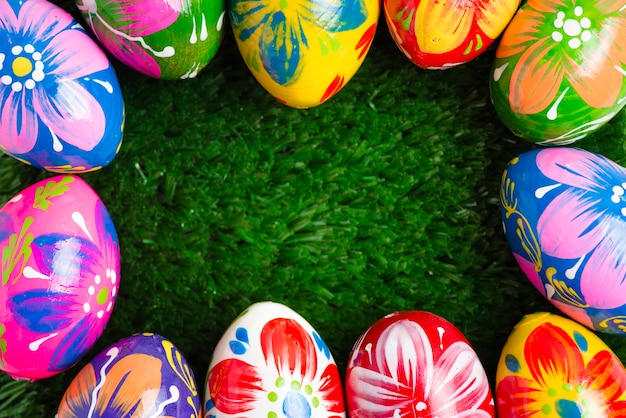 Grass background with easter eggs frame Free Photo