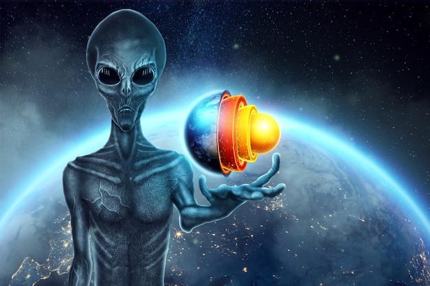 Серый инопланетянин, гуманоид, держит на руке голограмму земного шара. концепция нло, инопланетяне, контакт с внеземной цивилизацией. Premium Фотографии