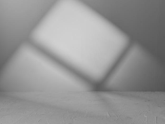 제품 프리젠 테이션을 위해 창에서 나오는 빛이있는 회색 배경 프리미엄 사진