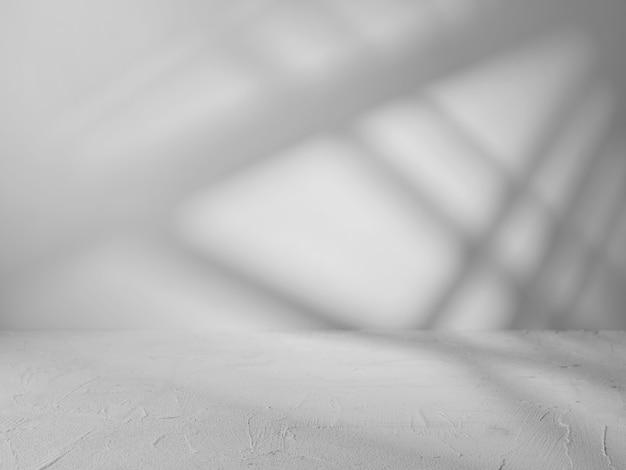 제품 발표를위한 빛의 광선을 가진 회색 배경 프리미엄 사진