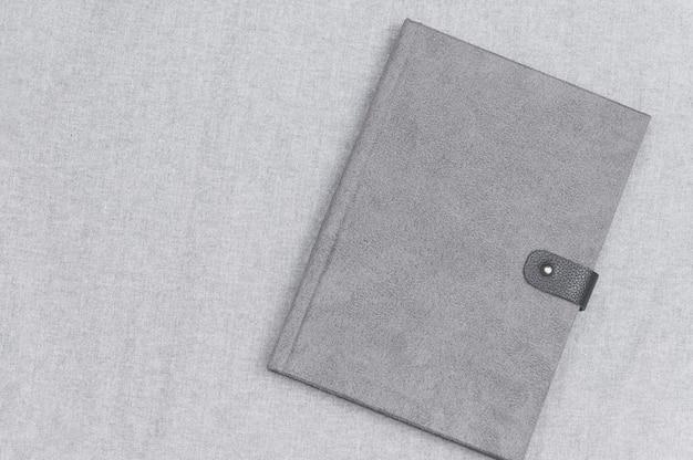 Gray book book on the gray cloth Premium Photo