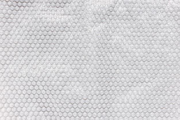 包装用の灰色の泡箔、テクスチャ背景 Premium写真