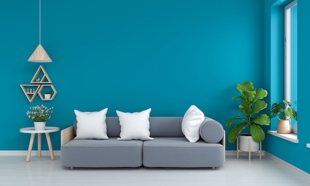 Gray sofa and table in blue living room Premium Photo
