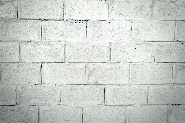 灰色のスタッコのレンガの壁。レンガの模様を付けたスタッコの模様。灰色のセメントの背景 Premium写真