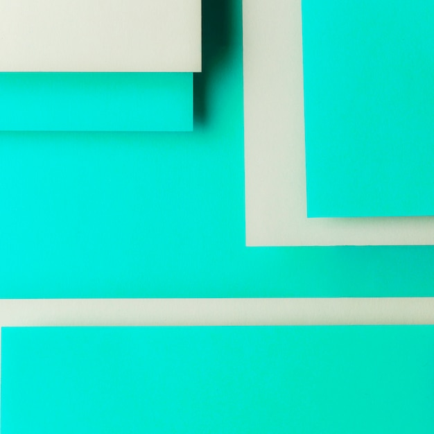 Gray and turquoise card paper in geometric shape Free Photo