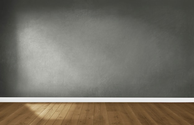 Gray wall in an empty room with a wooden floor Free Photo