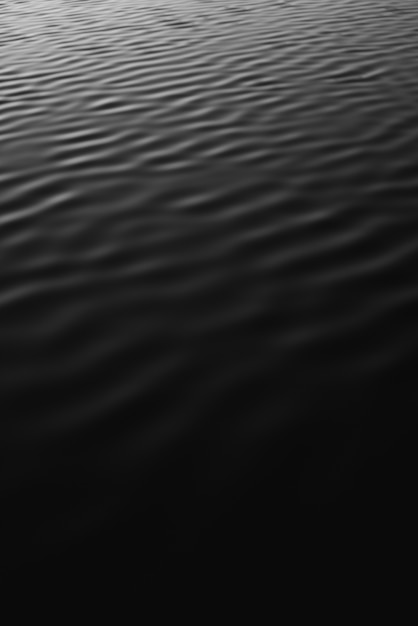 Colpo verticale di gradazione di grigio dell'acqua di mare Foto Gratuite