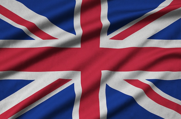 Great britain flag is depicted on a sports cloth fabric with many folds. Premium Photo