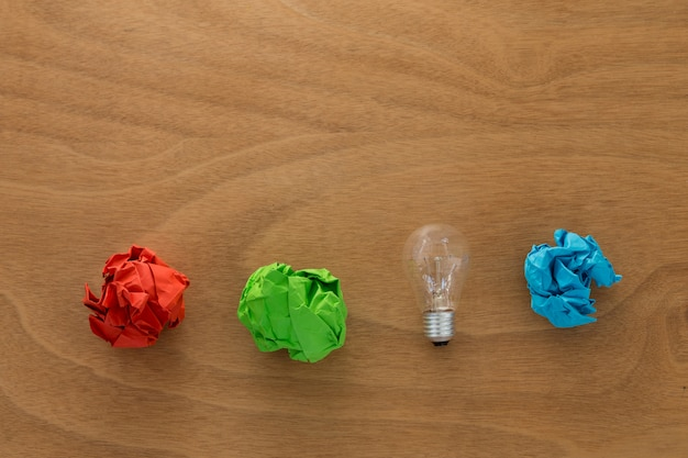 Great idea concept with crumpled colorful paper and light bulb Premium Photo