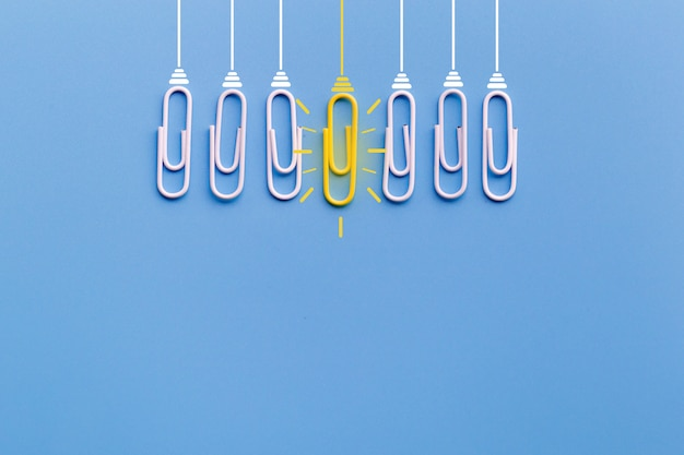 Great ideas concept with paperclip,thinking,creativity,light bulb on blue background. Premium Photo