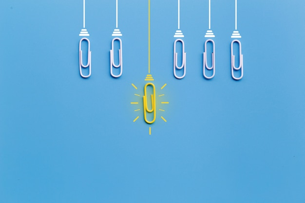 Great ideas  with paperclip,thinking,creativity,light bulb on blue background,new ideas Premium Photo