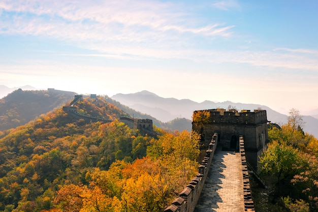 Great wall of china in colorful autumn season during sunset near beijing, china. Premium Photo