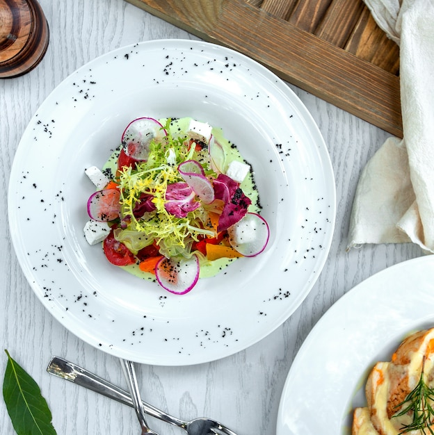 Greek salad decorated with radish slices Free Photo