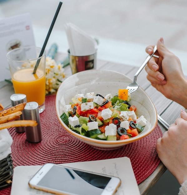 Greek salad on the table Free Photo