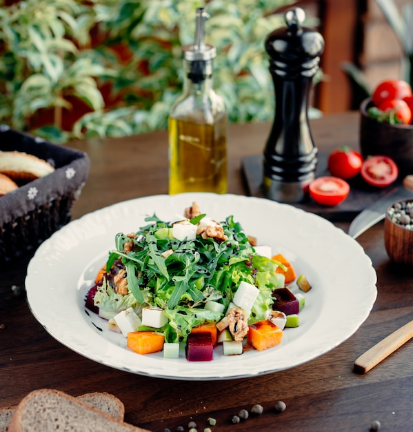 Greek salad with vegetables on the table Free Photo
