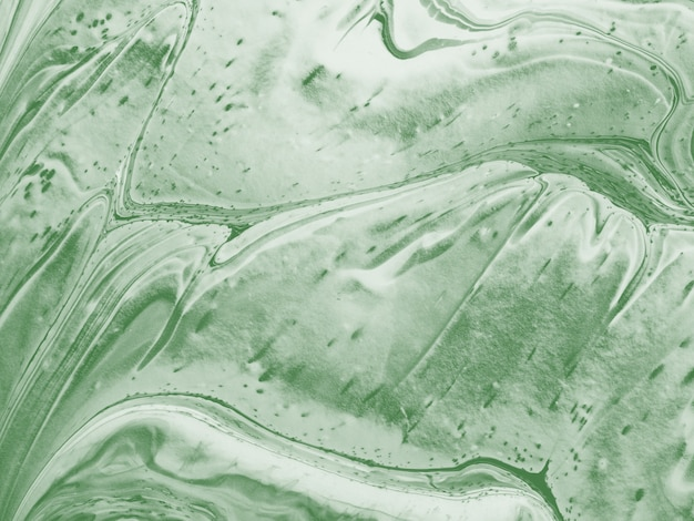 Green abstract background made with fluid art technique. Premium Photo