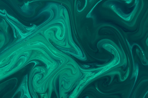 Green acrylic paint on water surface background Free Photo