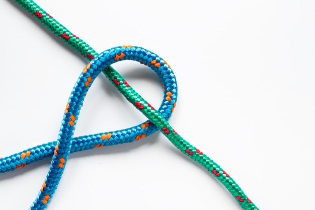 Зеленый и синий узел матросской веревки Premium Фотографии