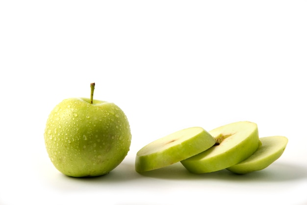 Green apple whole and sliced on white Free Photo