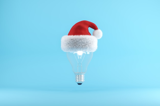 Green apple with santa hat floating on blue Premium Photo