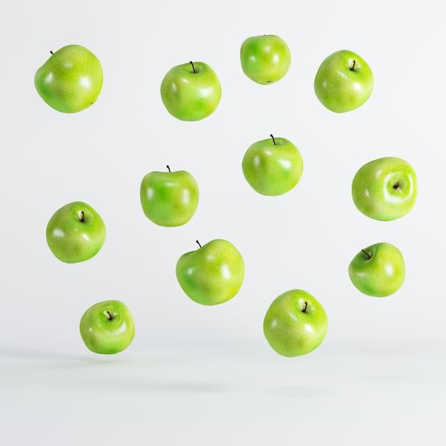 Green apples floating on white background. minimal idea food concept. Premium Photo