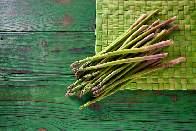 Green asparagus fresh on wood table Premium Photo