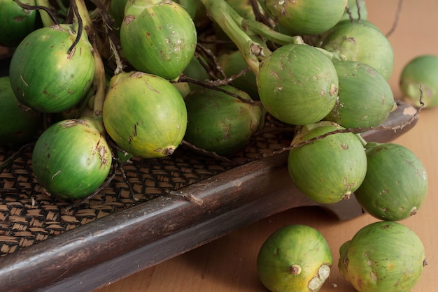 Green betel nut on tray. Premium Photo