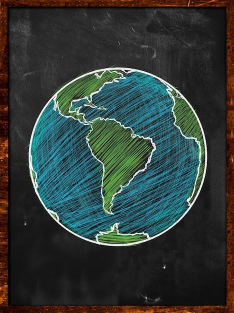 Green blue earth on blackboard globe Free Photo