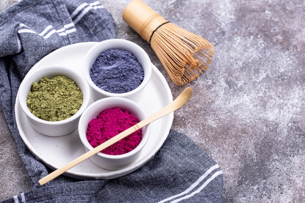Green, blue and pink matcha powder Premium Photo