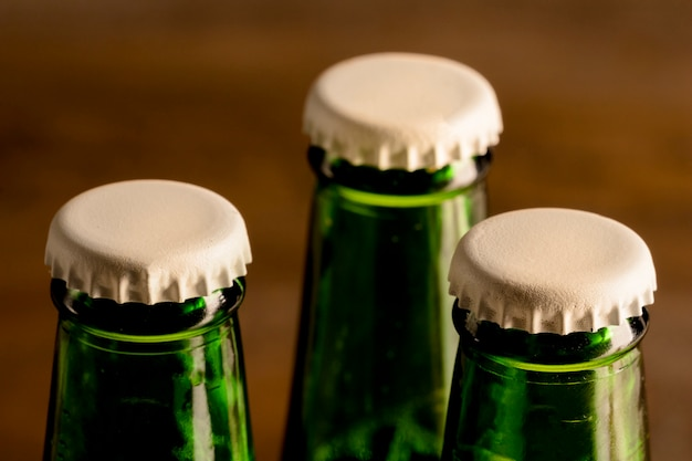 Green bottles of alcoholic drink with white caps Free Photo
