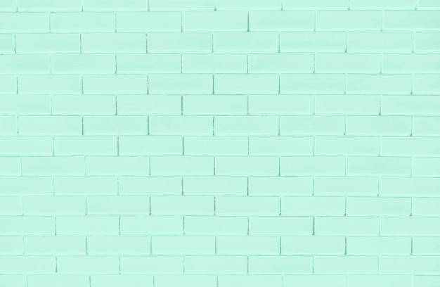 Green brick wall textured background Free Photo