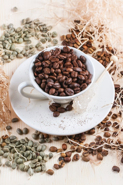 Green, brown and black coffee beans Premium Photo