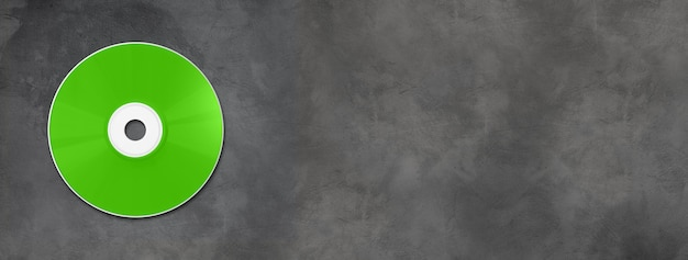 Green cd - dvd label mockup template isolated on horizontal concrete banner Premium Photo