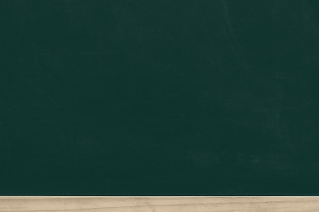 Green chalk board with wooden frame Premium Photo