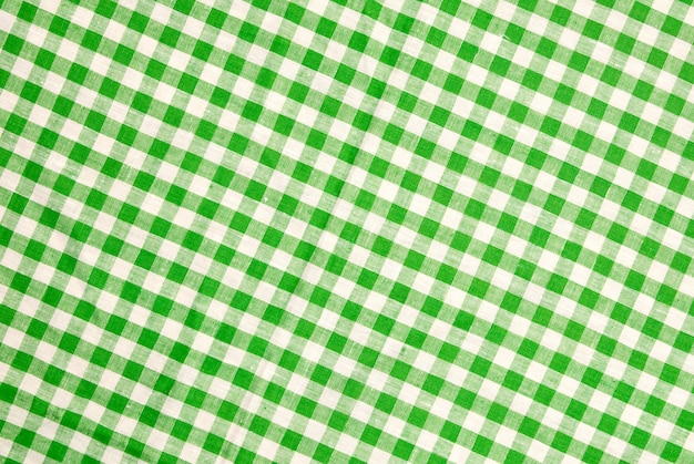 緑の市松模様のテーブルクロスの背景 Premium写真