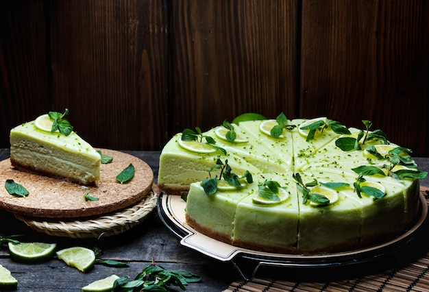 Green cheesecake topped with lemon and mint Free Photo