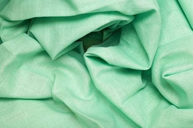抽象的な背景として緑の布 無料写真