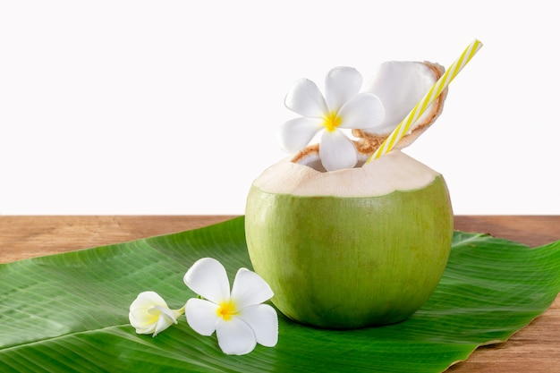 Green coconut fruit cut open to drink juice and eat. Premium Photo