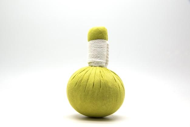 Green compress ball on white. Premium Photo