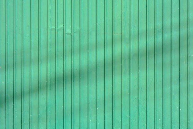Green corrugated metal roof with shadow Premium Photo