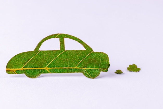 Green energy car made from green leaves. world environment concept or eco concept. Premium Photo