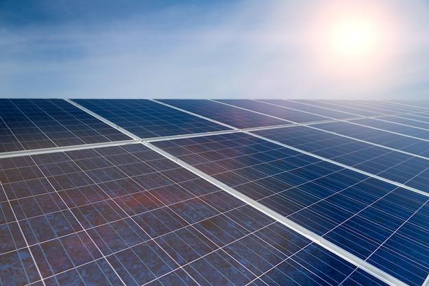 Green energy, solar panels with blue sky Premium Photo