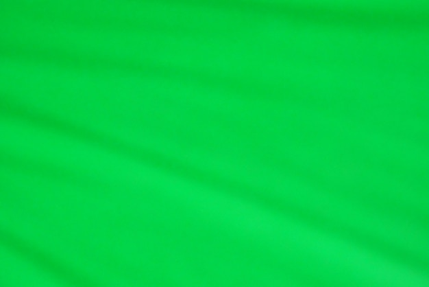 Green fabric texture as background. Premium Photo