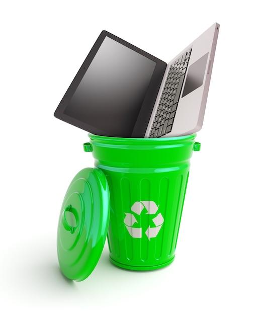 コンピューターが付いている緑のゴミ箱 Premium写真