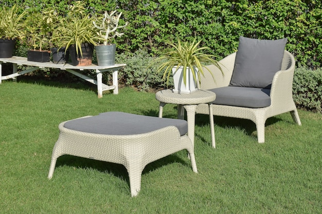 Green garden with an outdoor furniture lounge group with rattan Premium Photo