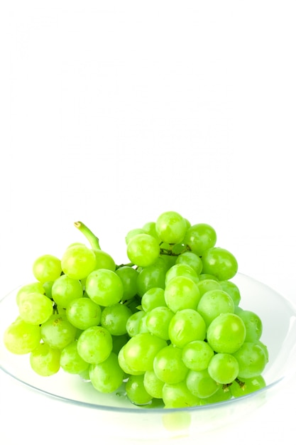 Green grapes in bowl on white background Premium Photo