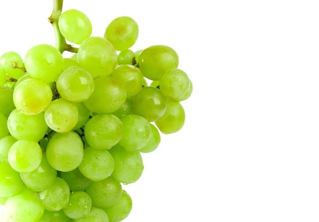 Green grapes closeup on white background Premium Photo